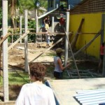 A group of volunteers builds a prefab. classroom for a school in Playa Chiquita, Puerto Viejo