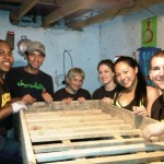 Francisco with a group of Adelphi University students help deliver a bunkbed in La Carpio