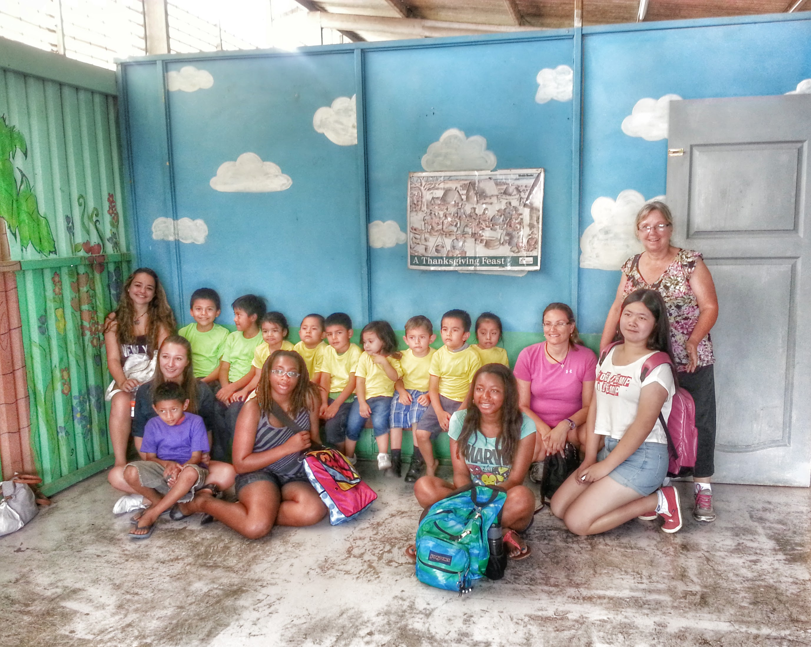 Part of a group of volunteers pose with a group of students from the Montesorri school in La Carpio